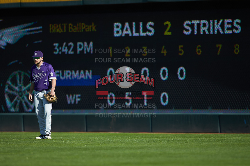 Furman Paladins right fielder David Webel (5) on defense against the Wake Forest Demon Deacons at BB&T BallPark on March 2, 2019 in Charlotte, North Carolina. The Demon Deacons defeated the Paladins 13-7. (Brian Westerholt/Four Seam Images)