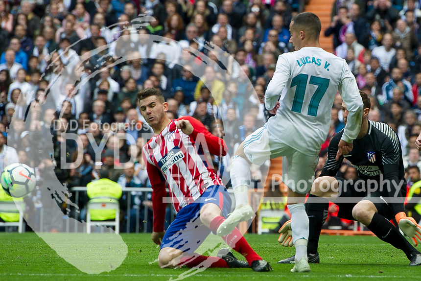 Real Madrid's Spanish midfielder Lucas Vazquez; Atletico Madrid's French defender Lucas Hernadez<br /> Spanish league football match Real Madrid vs Atletico de Madrid at the Santiago Bernabeu stadium in Madrid on April 8, 2018.