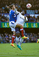 Adebayo Akinfenwa of Wycombe Wanderers and Christian Burgess of Portsmouth during the FA Cup 1st round match between Portsmouth and Wycombe Wanderers at Fratton Park, Portsmouth, England on the 5th November 2016. Photo by Liam McAvoy.