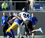 BROOKINGS, SD - NOVEMBER 5:  Jake Wieneke #19 from South Dakota State is hit before the ball reaches him by Darius Daniel #24 form Missouri State in the first half Saturday afternoon at Dana J. Dykhouse Stadium in Brookings. (Photo by Dave Eggen/Inertia)