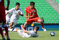 .Action photo of Alejandro Guido (L) of USA and Ales Cermak of the Czech Republic (R), during game of the FIFA Under 17 World Cup game, held at  Torreon.