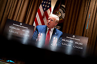 United States President Donald J. Trump makes remarks as he attends a meeting with Governor Asa Hutchinson (Republican of Arkansas) and Governor Laura Kelly (Democrat of Kansas) in the Cabinet Room of the White House in Washington, DC,  Wednesday, May 20, 2020.   <br /> Credit: Doug Mills / Pool via CNP/AdMedia