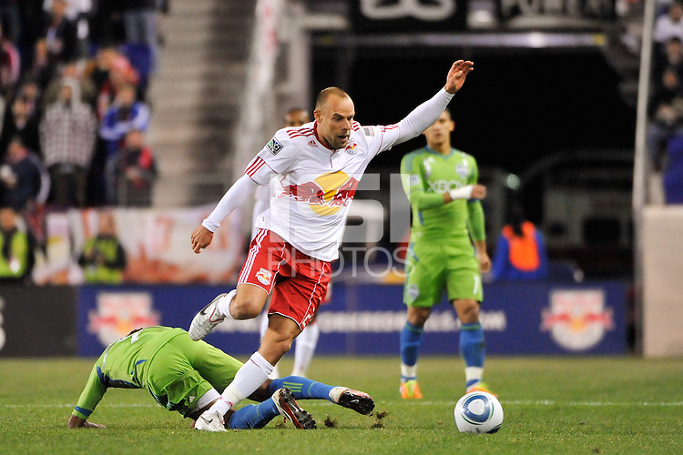 Joel Lindpere (20) of the New York Red Bulls jumps over a tackle. The New York Red Bulls defeated the Seattle Sounders 1-0 during a Major League Soccer (MLS) match at Red Bull Arena in Harrison, NJ, on March 19, 2011.