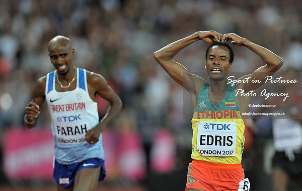 Muktar EDRIS (ETH) does the MOBOT as he wins the mens 5000m final, with Mo Farah (GBR) looking at him in the background. IAAF world athletics championships. London Olympic stadium. Queen Elizabeth Olympic park. Stratford. London. UK. 12/08/2017. ~ MANDATORY CREDIT Garry Bowden/SIPPA - NO UNAUTHORISED USE - +44 7837 394578