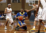 SIOUX FALLS, SD - NOVEMBER 26:  Tevin King #2 from South Dakota State University looks for a teammate out of a triple team from East Tennessee State University during their game at the Sanford Pentagon Saturday evening in Sioux Falls. (Photo by Dave Eggen/Inertia)