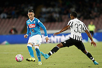 Calcio, Serie A: Napoli vs Juventus. Napoli, stadio San Paolo, 26 settembre 2015. <br /> Napoli&rsquo;s Jose' Maria Callejon, left, is challenged by Juventus&rsquo; Patrice Evra during the Italian Serie A football match between Napoli and Juventus at Naple's San Paolo stadium, 26 September 2015.<br /> UPDATE IMAGES PRESS/Isabella Bonotto