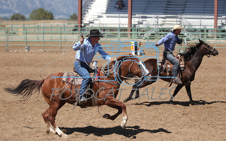 Justin McEwen and Ryan Carey compete in the double mugging event at the Minden Ranch Rodeo on Sunday, July 24, 2011, in Gardnerville, Nev. .Photo by Cathleen Allison