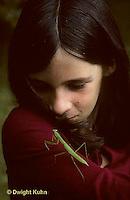 1M17-211z  Child looking at Chinese praying mantis nymph - Tenodera aridifolia sinensis