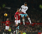 Ashley Fletcher of West Ham United gets above Marcos Rojo of Manchester United during the English League Cup Quarter Final match at Old Trafford  Stadium, Manchester. Picture date: November 30th, 2016. Pic Simon Bellis/Sportimage