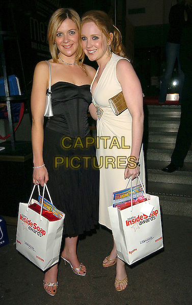 JANE DANSON & JULIA HAWORTH.Inside Soap Awards 2005.September 26th, 2005.full length goody bag cream dress black dress.www.capitalpictures.com.sales@capitalpictures.com.©Capital Pictures