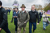 Nigel Farage  escorted by security after disruption by SWP.  UKIP leader Nigel Farage and ex-Tory MP Mark Reckless, the UKIP candidate, canvas in Rochester before the Rochester and Strood by-election.