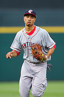 Pawtucket Red Sox center fielder Mookie Betts (12) jogs off the field between innings of the game against the Charlotte Knights at BB&T Ballpark on August 9, 2014 in Charlotte, North Carolina.  The Red Sox defeated the Knights  5-2.  (Brian Westerholt/Four Seam Images)
