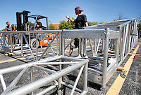 NWA Media/DAVID GOTTSCHALK - 9/22/14 - Terry Curtis, with Rock City Staging, helps direct the construction of the canopy for the main stage of Bikes, Blues & BBQ in the Walton Arts Center parking lot on Dickson Street and West Street Monday September 22, 2014 in Fayetteville. This is the 15th year for the motorcycle rally that runs from September 24 through September 27 with music, vendors, activities and events taking place throughout Fayetteville and Northwest Arkansas.