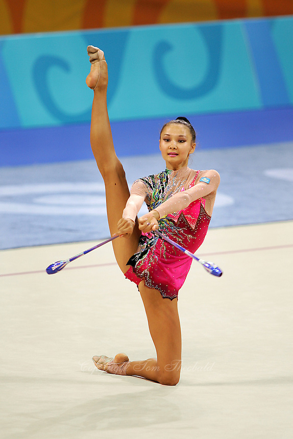 Aliya Yussupova competing for Kazakhstan mills with clubs during All-Around final at Athens Olympic Games on August 29, 2004 at Athens, Greece. (Photo by Tom Theobald)