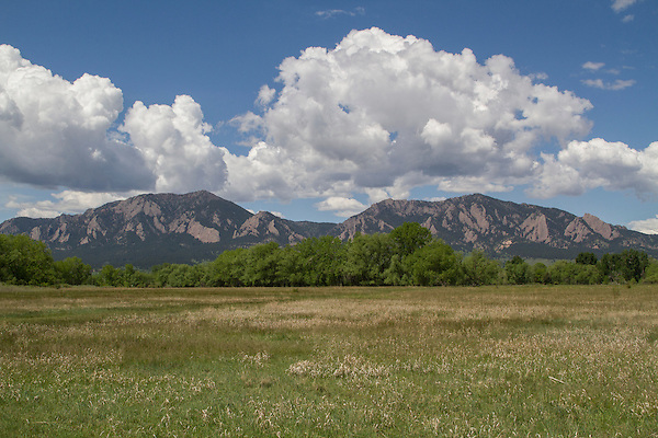 Cumulus clouds over the Flatirons rock formation, Boulder Valley, Colorado, .  John leads private photo tours in Boulder and throughout Colorado. Year-round Colorado photo tours.
