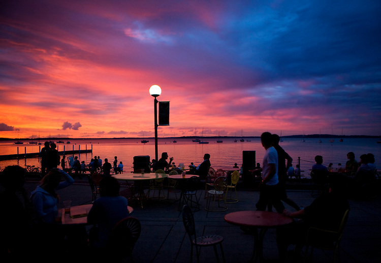 The sky lights up in a sunset over Lake Mendota, from the University of Wisconsin, Madison's Memorial Union Terrace.