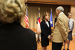 "April 16, 2014. Durham, North Carolina.<br />  Senator Kay Hagan, center, spoke with Bill Jeffries after an event to award a posthumous Bronze Star at a local retirement community. Hagan has been largely absent from the campaign trail even as several Republican challengers have mounted campaigns to defeat her in this year's election.<br />  Kay Hagan (D),  US Senator from North Carolina, attended an event to honor the military service of Donald ""Buddy"" Moore, Hagan awarded Moore's widow Wanda a posthumous Bronze Star, as well as several other medals, for his service in World War II."