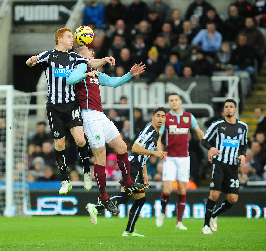 Newcastle United's Jack Colback vies for possession with Burnley's David Jones<br /> <br /> Photographer Chris Vaughan/CameraSport<br /> <br /> Football - Barclays Premiership - Newcastle United v Burnley - Thursday 1st January 2015 - St James' Park - Newcastle<br /> <br /> &copy; CameraSport - 43 Linden Ave. Countesthorpe. Leicester. England. LE8 5PG - Tel: +44 (0) 116 277 4147 - admin@camerasport.com - www.camerasport.com