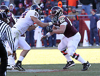Nov 27, 2010; Charlottesville, VA, USA;  Virginia Tech Hokies center Beau Warren (60) blocks Virginia Cavaliers defensive end Matt Conrath (94) during the game at Lane Stadium. Virginia Tech won 37-7. Mandatory Credit: Andrew Shurtleff-