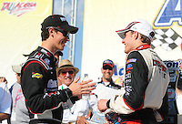Apr 25, 2009; Talladega, AL, USA; NASCAR Nationwide Series driver Joey Logano (left) congratulates David Ragan after winning the Aarons 312 at the Talladega Superspeedway. Mandatory Credit: Mark J. Rebilas-