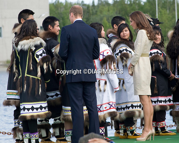 "PRINCE WILLIAM & KATE.official welcome to Yellowknife in the North West Terrorities on the 6th day of their Canadian Royal Tour.The Royal Couple observed a number of traditional activities at Somba K'e Civic Plaza, with .Prince William also participating in a street hockey penalty shoot-out, Yellowknife_05/07/2011.Mandatory Credit Photo: ©DIAS-DIASIMAGES..**ALL FEES PAYABLE TO: ""NEWSPIX INTERNATIONAL""**..IMMEDIATE CONFIRMATION OF USAGE REQUIRED:.DiasImages, 31a Chinnery Hill, Bishop's Stortford, ENGLAND CM23 3PS.Tel:+441279 324672  ; Fax: +441279656877.Mobile:  07775681153.e-mail: info@newspixinternational.co.uk"