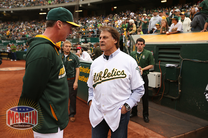 OAKLAND, CA - AUGUST 9:   Hall of Fame Manager Tony La Russa talks with manager Bob Melvin #6 of the Oakland Athletics before the game against the Minnesota Twins at O.co Coliseum on Saturday, August 9, 2014 in Oakland, California. Photo by Brad Mangin