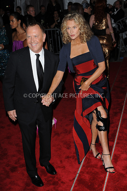 WWW.ACEPIXS.COM . . . . . ....May 4 2009, New York City....(L-R) Designer Michael Kors and model Lauren Hutton arriving at 'The Model as Muse: Embodying Fashion' Costume Institute Gala at The Metropolitan Museum of Art on May 4, 2009 in New York City.....Please byline: KRISTIN CALLAHAN - ACEPIXS.COM.. . . . . . ..Ace Pictures, Inc:  ..tel: (212) 243 8787 or (646) 769 0430..e-mail: info@acepixs.com..web: http://www.acepixs.com