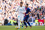 Carlos Henrique Casemiro (L) of Real Madrid is followed by Luis Alberto Suarez Diaz of FC Barcelona during the La Liga 2017-18 match between Real Madrid and FC Barcelona at Santiago Bernabeu Stadium on December 23 2017 in Madrid, Spain. Photo by Diego Gonzalez / Power Sport Images
