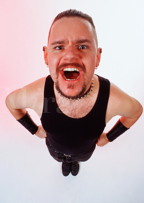 Punk lifestyle: tough-looking man, glaring