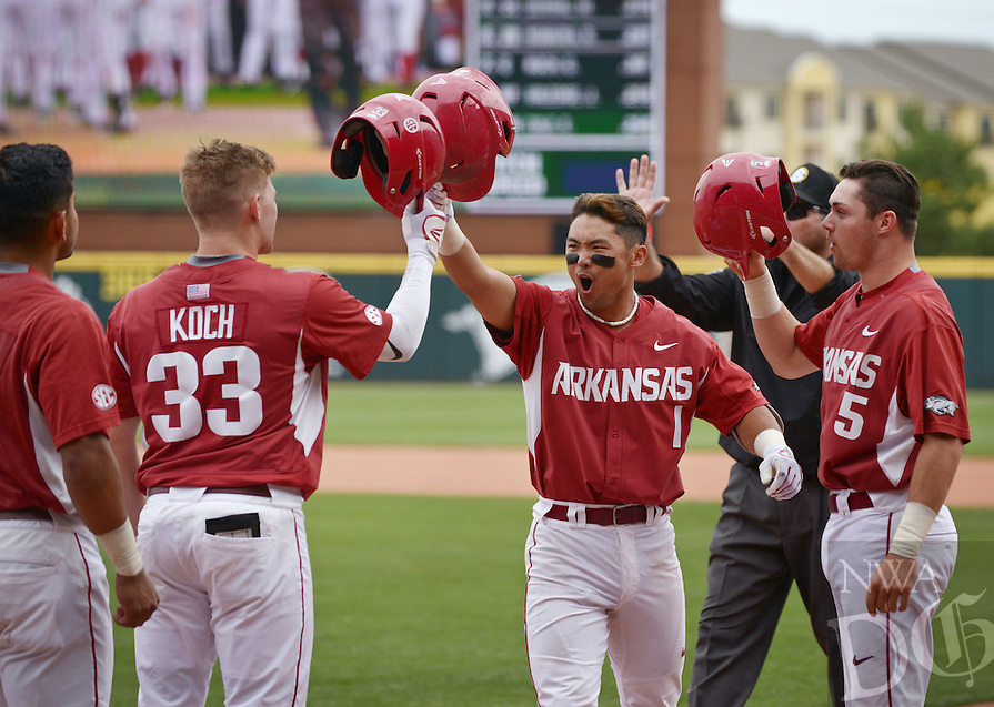 Grant Koch (33), and Cody Scroggins (5) congratulate Rick Nomura, Arkansas second baseman, after he hit a home run in the 8th inning against Alabama on Sunday May 15, 2016 during the game in Baum Stadium in Fayetteville.