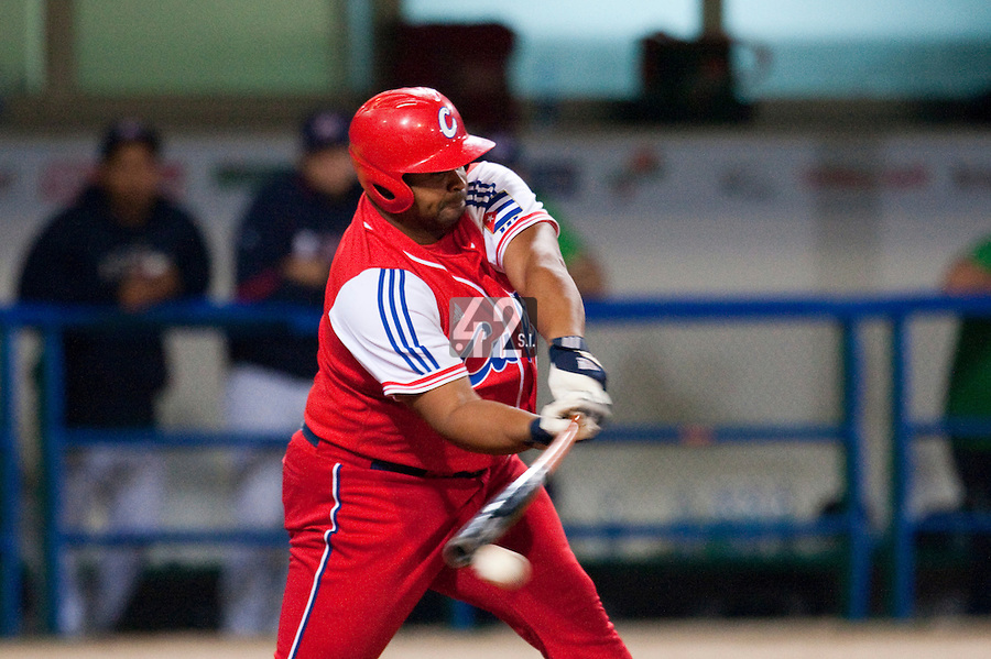 24 September 2009: Yosvany Peraza of Cuba connects during the 2009 Baseball World Cup final round match won 5-3 by Team USA over Cuba, in Nettuno, Italy.