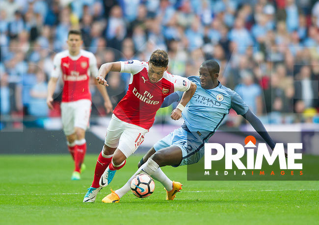 Arsenal's Alex Oxlade-Chamberlain  and Manchester City Yaya Toure  during the FA Cup Semi Final match between Manchester City and Arsenal at the Wembley  Stadium, Manchester, England on 23 April 2017. Photo by Andrew Aleksiejczuk / PRiME Media Images.