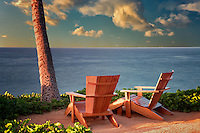 Two adirondac chairs overlooking ocean at Four Sesons. Lanai, Hawaii.