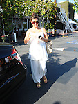 ....May 16th 2012..Kourtney Kardashian pregnant leaving Fred Segal in West Hollywood wearing all white like a white ghost angel. ..AbilityFilms@yahoo.com.805-427-3519.www.AbilityFilms.com.