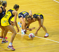 Jamie-Lee Price and Liana Leota compete for the ball during the ANZ Netball Championship match between the Central Pulse and Waikato Bay Of Plenty Magic at TSB Bank Arena, Wellington, New Zealand on Monday, 30 March 2015. Photo: Dave Lintott / lintottphoto.co.nz
