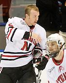 Jake Newton (NU - 5) - The Northeastern University Huskies defeated the Bentley University Falcons 3-2 on Friday, October 16, 2009, at Matthews Arena in Boston, Massachusetts.