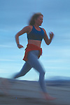 Woman running in the dunes