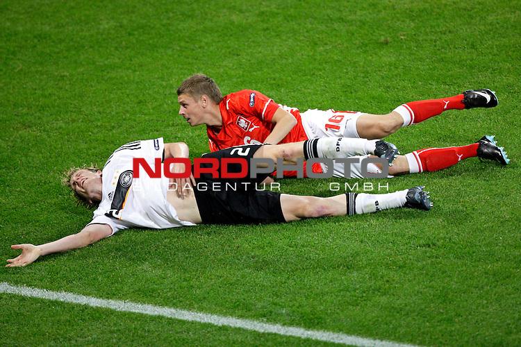 UEFA Euro 2008 Group B Klagenfurt - W&ouml;rthersee Match 04<br /> <br /> Deutschland ( GER ) - Polen ( POL ) 2:0 (1:0)<br /> <br /> Marcell Jansen ( Germany  / Verteidiger / Defender / Bayern Muenchen #2) und Jakub Blaszczykowski  (  Poland / Mittelfeldspieler / Midfielder / Borussia Dortmund #16 ) am Boden<br /> <br /> Foto &copy; nph (  nordphoto  )<br /> <br /> <br /> <br />  *** Local Caption ***