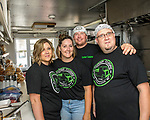 Prairie Meadows was a buss with exotic and worldly foods during its Food Truck Festival held June 17. Curbin' Cuisine serves globally inspired foods and is very busy groups project. Workers include, from left, Suzanne Hofer, owners Misty and Jarrod Fontanini and their chef, Matt Bingham.