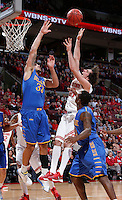 Ohio State Buckeyes guard Amedeo Della Valle (33) goes against Delaware Blue Hens forward Carl Baptiste (33) and draws the foul during the first half of the NCAA men's basketball game at Value City Arena on Wednesday, December 18, 2013. (Columbus Dispatch photo by Jonathan Quilter)