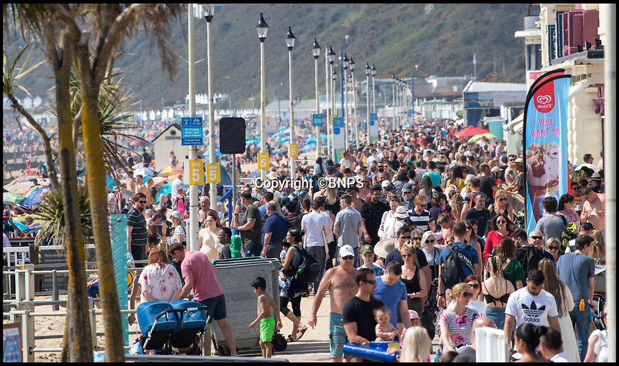 BNPS.co.uk (01202 558833)<br /> Pic: PhilYeomans/BNPS<br /> <br /> Promenade was swamped with visitors.<br /> <br /> Not enough room to roll an Easter egg...<br /> <br /> Bournemouth's beaches were packed with holidaymakers today as Brits flocked to the seaside in the spring heatwave.<br /> <br /> Tourism bosses estimated over 100,000 sun worshippers pored on to the resorts seven miles of beaches.