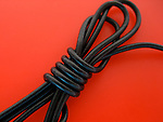 A macro shot of black cable wire