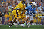 29 MAY 2011: Kevin McCormick (10) of Tufts University controls the ball against Salisbury University during the Division III Men's Lacrosse Championship held at M+T Bank Stadium in Baltimore, MD.  Salisbury defeated Tufts 19-7 for the national title. Larry French/NCAA Photos