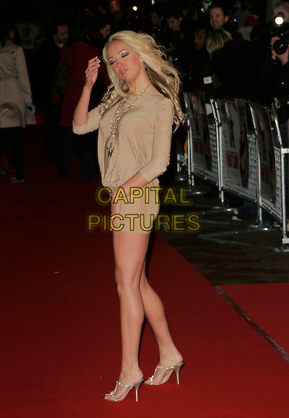 "AISLEYNE HORGAN-WALLACE.At the UK Premiere of ""I Want Candy"",.Vue Cinema West End, Leicester Square, .London, England, March 20th 2007..full length gold beige dress hands funny horgan wallace big brother .CAP/AH.©Adam Houghton/Capital Pictures."
