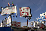 ALGODONES, MEXICO-MARCH 22: Advertisements for dentists and opticians fill the main street March 22, 2005 in Algodones. In just a few square blocks there are hundreds of dentists, doctors and optometrists to choose from.  The boom in cross border medical tourism has attracted more Mexicans to set up shop or seek employment in town. ©Radhika Chalasani