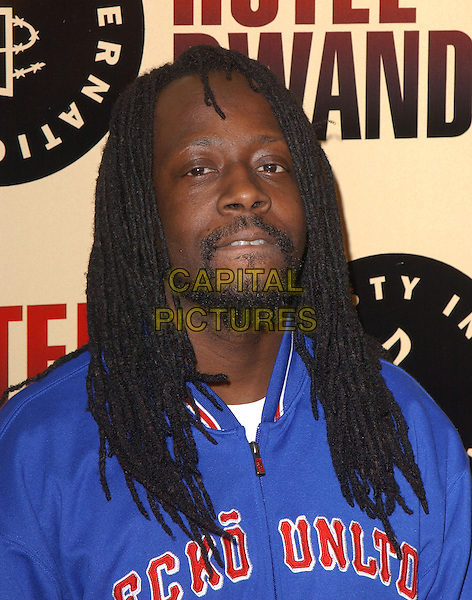 "WYCLEF JEAN.Los Angeles Premiere of ""Hotel Rwanda"" held at The Academy Theatre in Beverly Hills, California.December 2nd, 2004.headshot, portrait, goatee, facial hair,  dreadlocks, biting bottom lip.www.capitalpictures.com.sales@capitalpictures.com.Supplied by Capital Pictures."