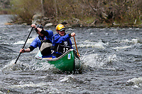 Two men paddling a canoe in the Hudson River White Water Derby In the Adirondack Mountains of New York State