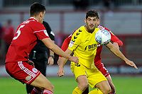 Ched Evans of Fleetwood Town vies for the ball with Ross Sykes of Accrington Stanley during the The Leasing.com Trophy match between Accrington Stanley and Fleetwood Town at the Fraser Eagle Stadium, Accrington, England on 3 September 2019. Photo by Greig Bertram / PRiME Media Images.