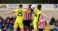 Lincoln City's John Akinde vies for possession with Cheltenham Town's Jordan Tillson, left, and Cheltenham Town's Charlie Raglan<br /> <br /> Photographer Chris Vaughan/CameraSport<br /> <br /> The EFL Sky Bet League Two - Lincoln City v Cheltenham Town - Saturday 13th April 2019 - Sincil Bank - Lincoln<br /> <br /> World Copyright &copy; 2019 CameraSport. All rights reserved. 43 Linden Ave. Countesthorpe. Leicester. England. LE8 5PG - Tel: +44 (0) 116 277 4147 - admin@camerasport.com - www.camerasport.com