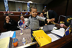 Nevada Assemblywoman Olivia Diaz, D-North Las Vegas, right rear, works with her son Xavier Carson Alejandre, 2, on the Assembly floor at the Legislative Building in Carson City, Nev., on Friday, May 24, 2013. <br /> Photo by Cathleen Allison